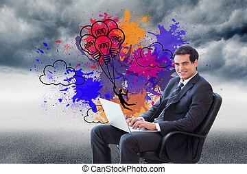 Composite image of portrait of a young businessman sitting on an armchair working with a laptop