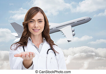 Composite image of portrait of female nurse holding out open...