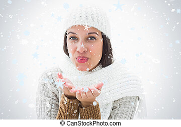 Composite image of pretty brunette blowing kiss to camera