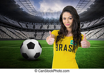 Composite image of pretty football fan in brasil tshirt -...