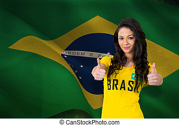 Composite image of pretty football fan in brasil tshirt -...