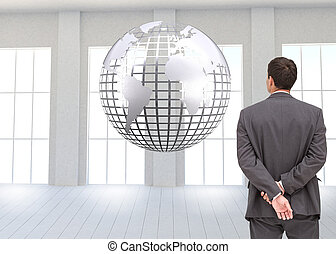 Composite image of rear view of classy businessman posing