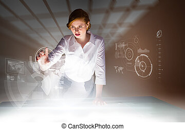 Redhead businesswoman using interactive desk against room with windows at ceiling