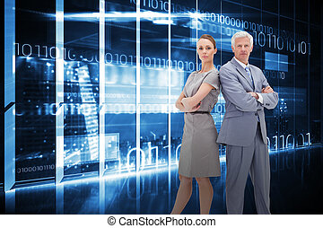 Composite image of serious businessman standing back-to-back...