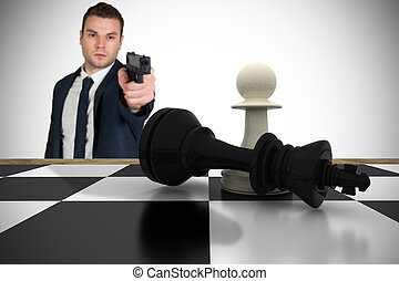 Composite image of serious businessman pointing a gun at chess p
