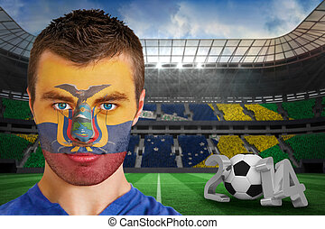 Composite image of serious young ecuador fan with face paint