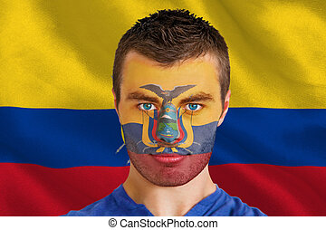 Composite image of serious young ecuador fan with facepaint