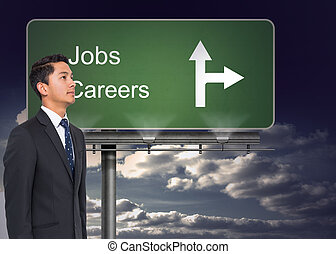Composite image of signpost showing the direction of jobs and careers with sky in the background
