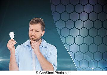 Composite image of skeptical model holding a bulb