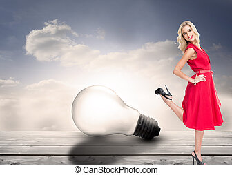 Composite image of smiling blonde standing hands on hips -...