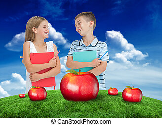 Composite image of smiling brother and sister holding their exer