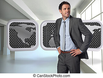 Composite image of smiling businessman with hands on hips - ...