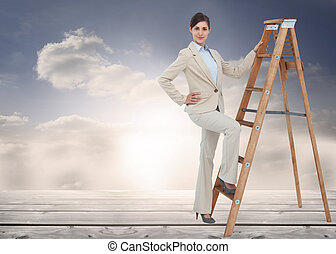 Composite image of smiling businesswoman climbing the career...