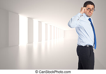 Thinking businessman tilting glasses against digitally generated room