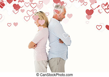 Composite image of unhappy couple not speaking to each other...