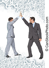 Composite image of unified business team high fiving each other