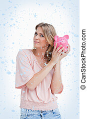 Composite image of woman holding a piggy bank up to her head