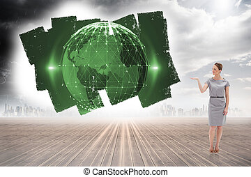 Composite image of woman in a dress holding her hand up