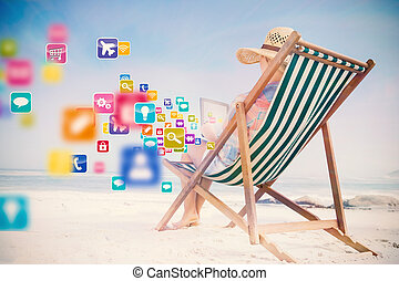 Composite image of woman in sunhat sitting on beach in deck ...