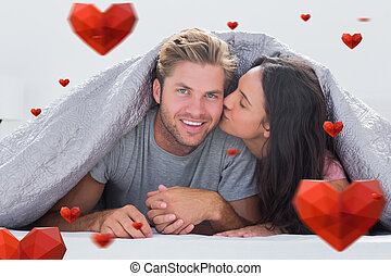 Composite image of woman kissing her husband