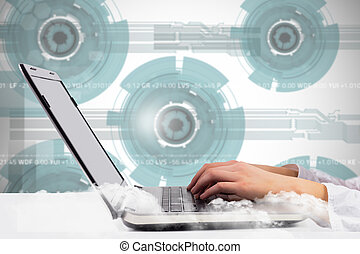 Composite image of woman typing on her laptop - Woman typing...