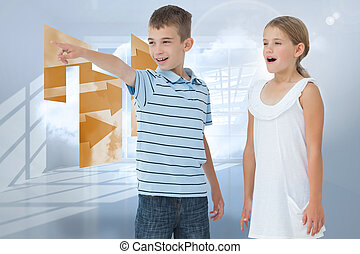 Composite image of young boy showing something to his sister