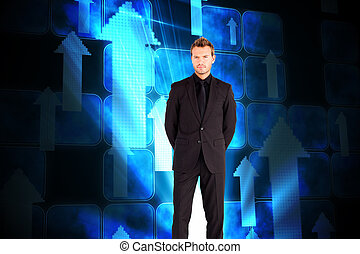 Composite image of young businessman looking at the camera