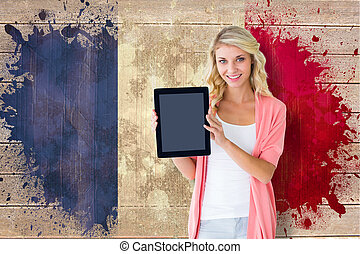 Composite image of young pretty student showing tablet pc -...