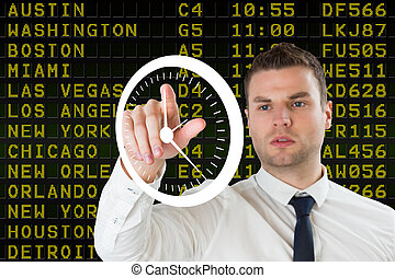 Composite image of young serious businessman pointing