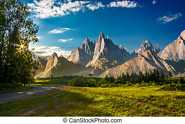 composite landscape with rocky peaks at sunset. beautiful...