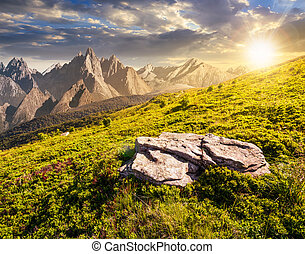 composite of meadow in rocky mountains at sunset. beautiful...
