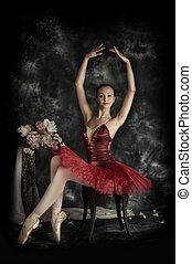 composition - Beautiful bellet dancer posing at studio over...