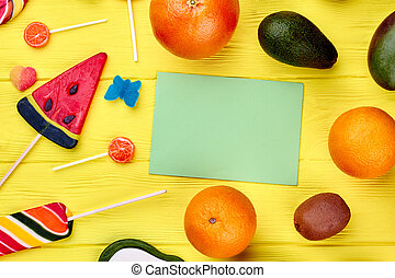 Composition from tropical fruits and candies. Mix of healthy...