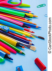 Composition lined with colorful school stationery. Flat lay