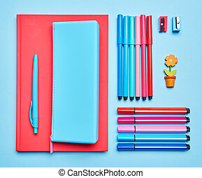 Composition lined with school supplies