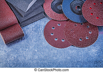 Composition of abrasive equipment on metallic background...