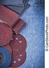 Composition of abrasive tools on metallic background top view
