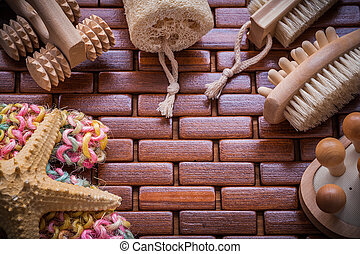 Composition of bath accessories on checked wooden table mat saun