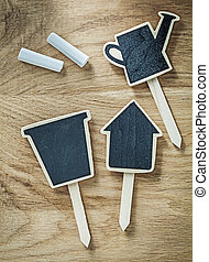 Composition of black wooden chalkboard price sign tags on wood b