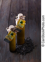 Composition of bottles with oil on wooden table