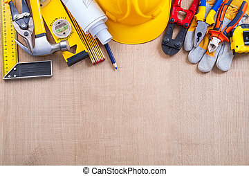 Composition of building tools on oak wooden board construction c