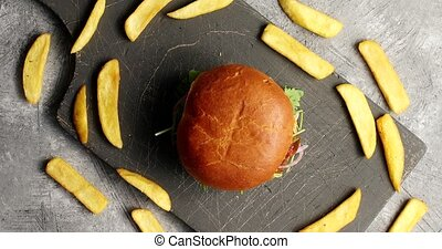 Composition of burger with fries - Top view of fresh burger...