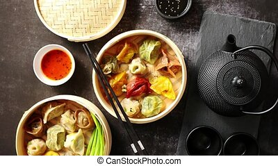 Composition of chinese food. Mixed kinds of dumplings from...