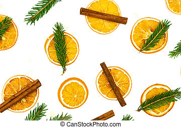 Composition of cinnamon, fur tree branches and dried oranges on white background. Flat lay, top view. Copy space for your design. Christmas or New Year concept.