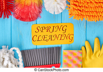Composition of colorful house cleaning products.