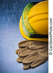 Composition of construction leather gloves building helmet and t