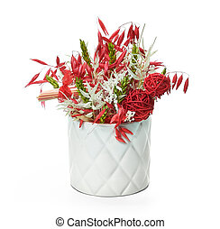 Composition of dried flowers in a vase on a white background