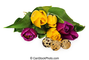 Composition of Easter eggs, flowers, tulips. Easter eggs in multicolored.