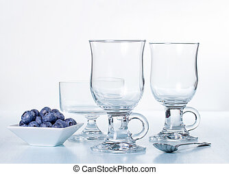 Composition of empty glasses and blueberries