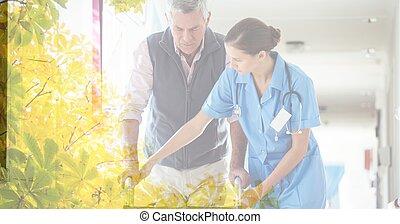 Composition of female nurse teaching senior caucasian man using walking frame with tree overlay
